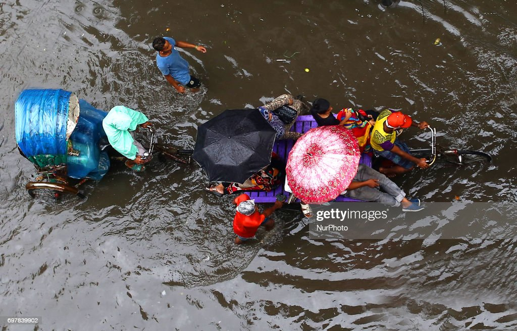 Torrential rains inundated many parts in Dhaka, Bangladesh on 19 June 2017. The photos are taken from Nazimuddin Road in Old Dhaka.