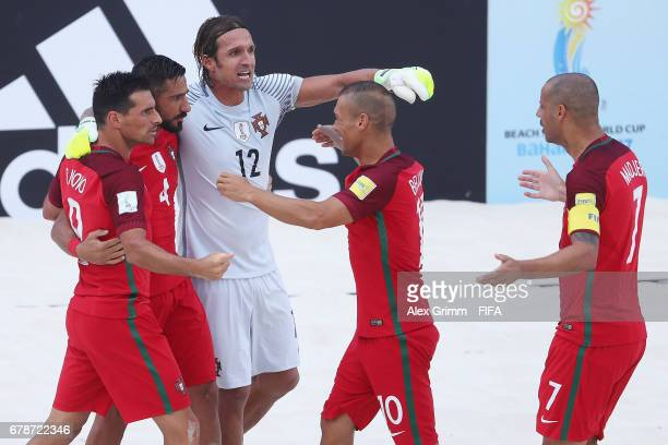 Torres of Portugal celebrates scoring the opening goal with team mates Bruno Novo Andrade Belchior and Madjer during the FIFA Beach Soccer World Cup...