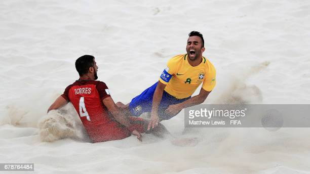 Torres of Portugal tackles Bruno Xavier of Brazil during the FIFA Beach Soccer World Cup Bahamas 2017 quarter final match between Brazil and Portugal...