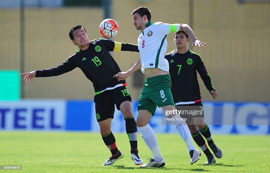 Torres Padilla of Mexico is tackled by Milen Gamakov of Bulgaria during the Toulon Tournament match between Bulgaria and Mexico at Stade Perruc on May 24, 2016 in Hyeres, France.