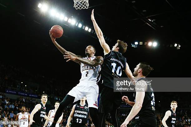 Torrey Craig of the Bullets goes to the basket against Tom Abercrombie of the Breakers during the round 10 NBL match between the New Zealand Breakers...