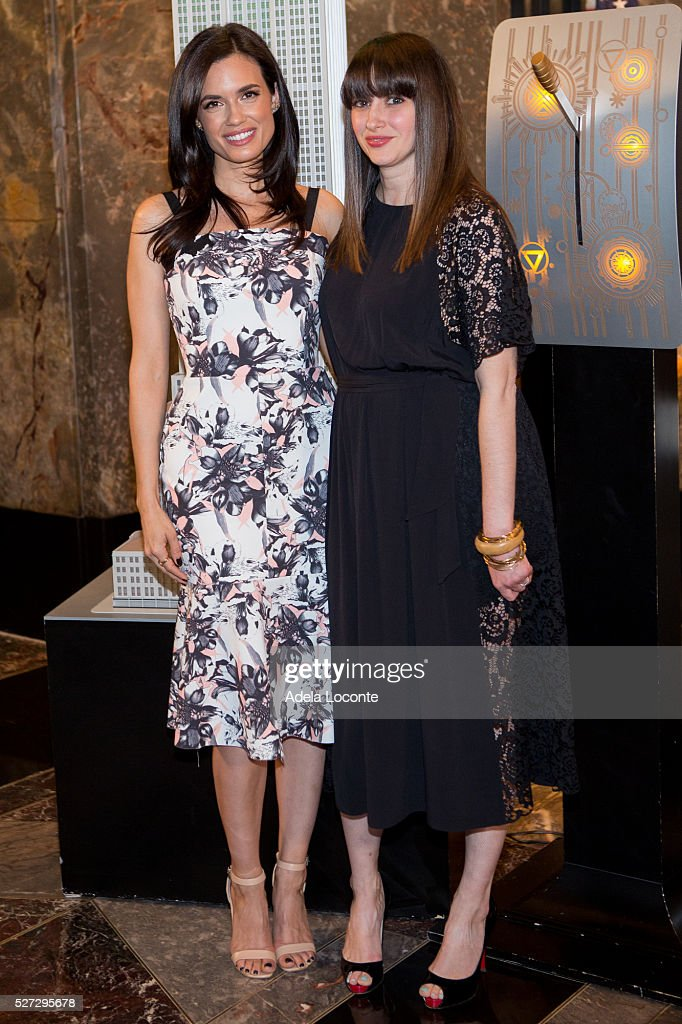 Torrey DeVitto and Amy Laird Light The Empire State Building Green In Honor Of Mental Health Monthat The Empire State Building on May 2, 2016 in New York City.