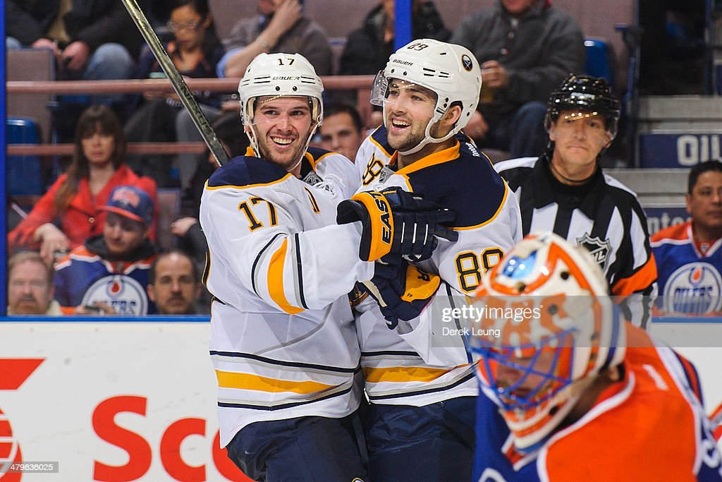 Torrey Mitchell #17 (L) congratulates Cory Conacher #88 of the Buffalo Sabres after scoring the team's second goal against Ben Scrivens #30 of the Edmonton Oilers during an NHL game at Rexall Place on March 20, 2014 in Edmonton, Alberta, Canada. The Sabres defeated the Oilers 3-1.