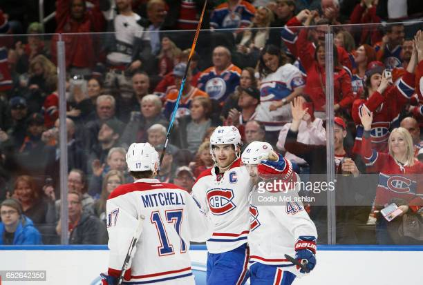 Torrey Mitchell Max Pacioretty and Paul Byron of the Montreal Canadiens celebrate a goahead goal against the Edmonton Oilers on March 12 2017 at...