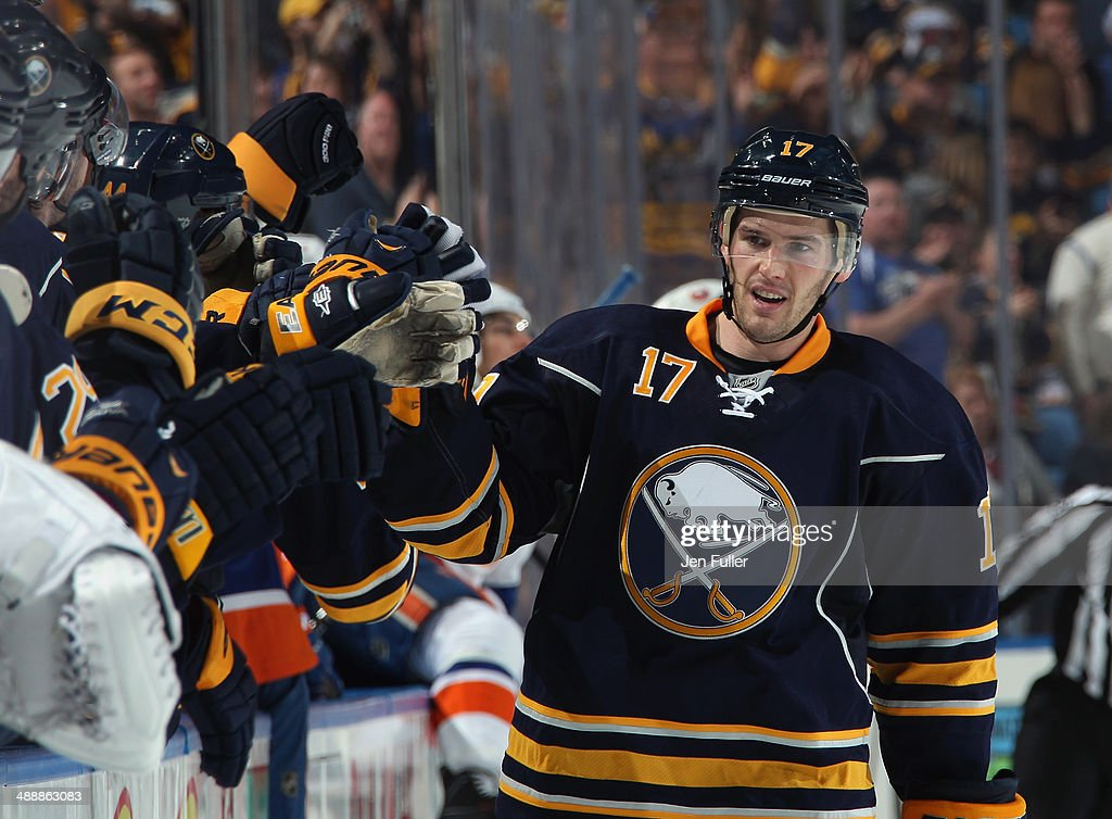 Torrey Mitchell #17 of the Buffalo Sabres celebrates a goal against the New York Islanders at First Niagara Center on April 13, 2014 in Buffalo, New York.