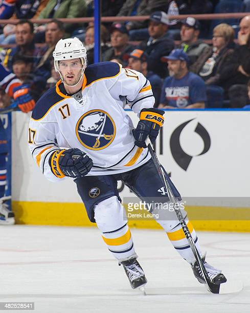 Torrey Mitchell of the Buffalo Sabres in action against the Edmonton Oilers during an NHL game at Rexall Place on March 20 2014 in Edmonton Alberta...