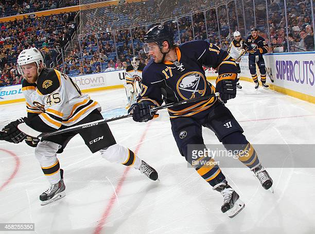 Torrey Mitchell of the Buffalo Sabres skates against Joe Morrow of the Boston Bruins on October 30 2014 at the First Niagara Center in Buffalo New...