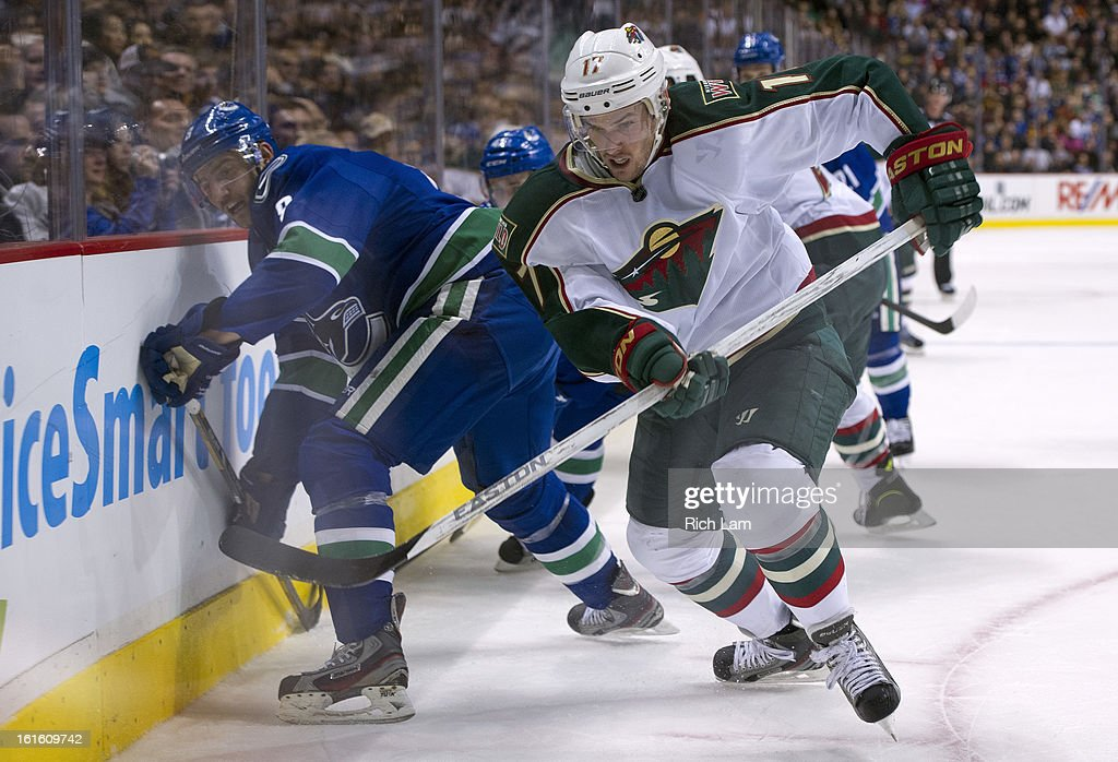 <a gi-track='captionPersonalityLinkClicked' href=/galleries/search?phrase=Torrey+Mitchell&family=editorial&specificpeople=4504539 ng-click='$event.stopPropagation()'>Torrey Mitchell</a> #17 of the Minnesota Wild chases after the loose puck after digging it free while battling with Chris Tanev #8 of the Vancouver Canucks during the third period in NHL action on February 12, 2013 at Rogers Arena in Vancouver, British Columbia, Canada.