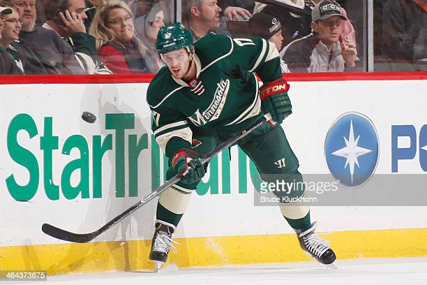 Torrey Mitchell of the Minnesota Wild clears the puck against the Washington Capitals during the game on January 4 2014 at the Xcel Energy Center in...