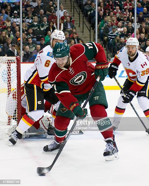 Torrey Mitchell of the Minnesota Wild controls the puck during the game against the Calgary Flames on March 3 2014 at Xcel Energy Center in St Paul...