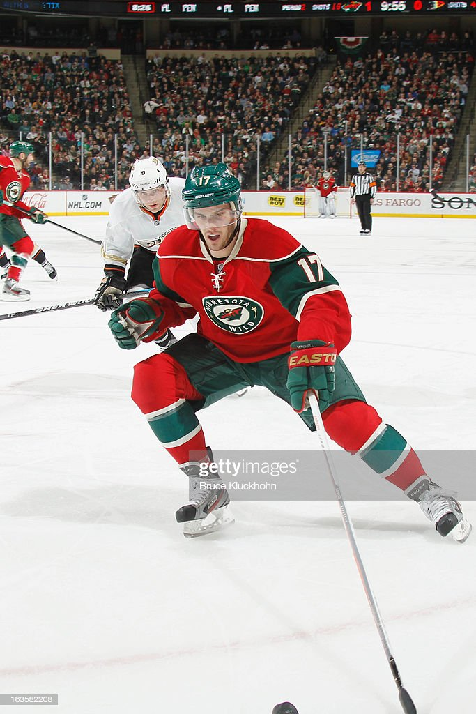 <a gi-track='captionPersonalityLinkClicked' href=/galleries/search?phrase=Torrey+Mitchell&family=editorial&specificpeople=4504539 ng-click='$event.stopPropagation()'>Torrey Mitchell</a> #17 of the Minnesota Wild controls the puck with <a gi-track='captionPersonalityLinkClicked' href=/galleries/search?phrase=Bobby+Ryan+-+Ice+Hockey+Player&family=editorial&specificpeople=877359 ng-click='$event.stopPropagation()'>Bobby Ryan</a> #9 of the Anaheim Ducks defending during the game on March 12, 2013 at the Xcel Energy Center in Saint Paul, Minnesota.