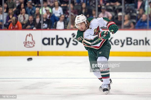 Torrey Mitchell of the Minnesota Wild dumps the puck into the Colorado Avalanche zone during a game at the Pepsi Center on April 27 2013 in Denver...