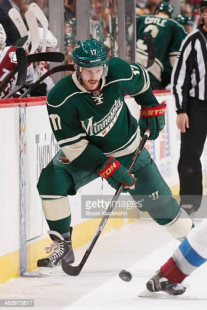 Torrey Mitchell of the Minnesota Wild handles the puck near the boards against the Colorado Avalanche during the game on November 29 2013 at the Xcel...