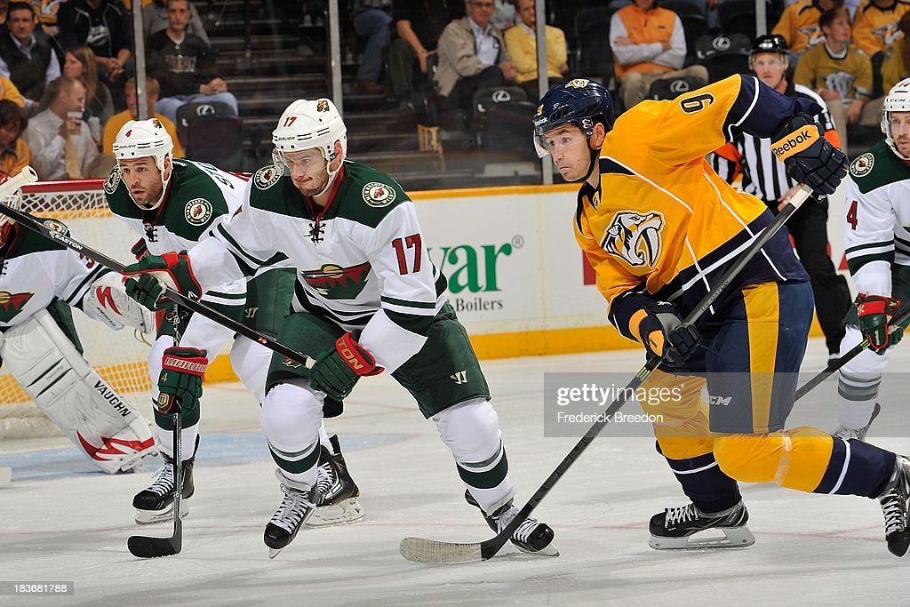 <a gi-track='captionPersonalityLinkClicked' href=/galleries/search?phrase=Torrey+Mitchell&family=editorial&specificpeople=4504539 ng-click='$event.stopPropagation()'>Torrey Mitchell</a> #17 of the Minnesota Wild plays against <a gi-track='captionPersonalityLinkClicked' href=/galleries/search?phrase=Filip+Forsberg&family=editorial&specificpeople=8768623 ng-click='$event.stopPropagation()'>Filip Forsberg</a> #9 of the Nashville Predators at Bridgestone Arena on October 8, 2013 in Nashville, Tennessee.