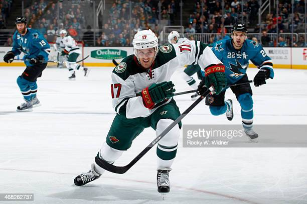 Torrey Mitchell of the Minnesota Wild skates after the puck against the San Jose Sharks at SAP Center on January 25 2014 in San Jose California