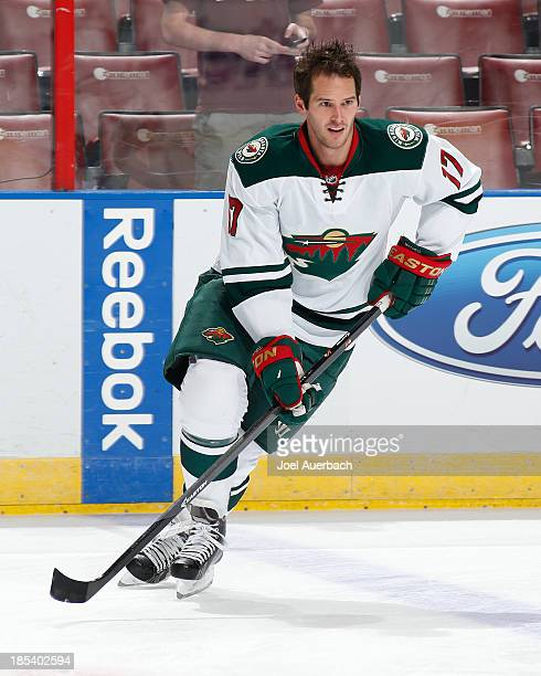 Torrey Mitchell of the Minnesota Wild skates prior to the game against the Florida Panthers at the BBT Center on October 19 2013 in Sunrise Florida...