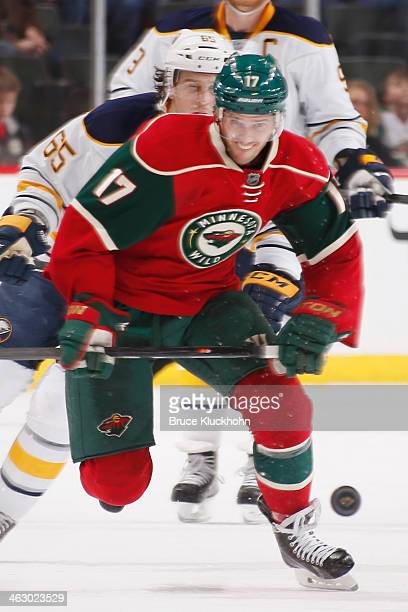 Torrey Mitchell of the Minnesota Wild skates to the puck against the Buffalo Sabres during the game on January 2 2014 at the Xcel Energy Center in St...