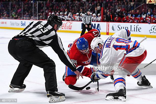 Torrey Mitchell of the Montreal Canadiens and JT Miller of the New York Rangers faceoff during the NHL game at the Bell Centre on January 14 2017 in...