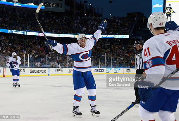 Torrey Mitchell of the Montreal Canadiens celebrates a goal by teammate Paul Byron during the third period against the Boston Bruins in the 2016...