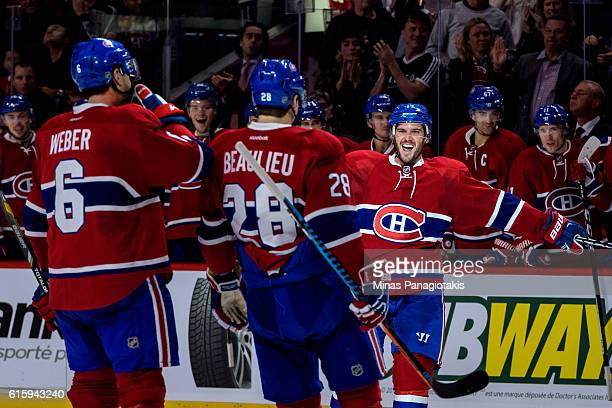 Torrey Mitchell of the Montreal Canadiens celebrates a goal with teammates during the NHL game against Arizona Coyotes at the Bell Centre on October...