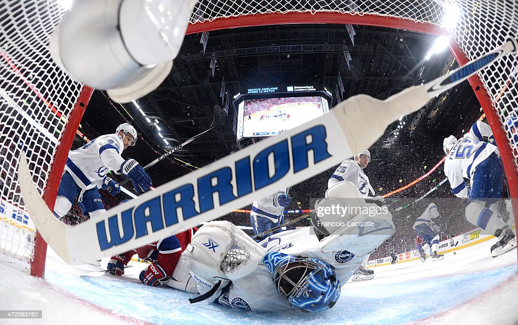 Torrey Mitchell #17 of the Montreal Canadiens collides with goaltender Ben Bishop #30 of the Tampa Bay Lightning in Game 2 of the Eastern Conference Semifinals during the NHL Stanley Cup Playoffs at the Bell Centre on May 03, 2015 in Montreal, Quebec, Canada.