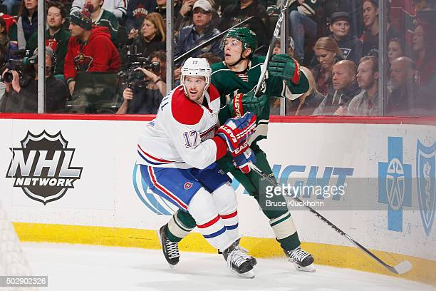 Torrey Mitchell of the Montreal Canadiens defends Zach Parise of the Minnesota Wild during the game on December 22 2015 at the Xcel Energy Center in...