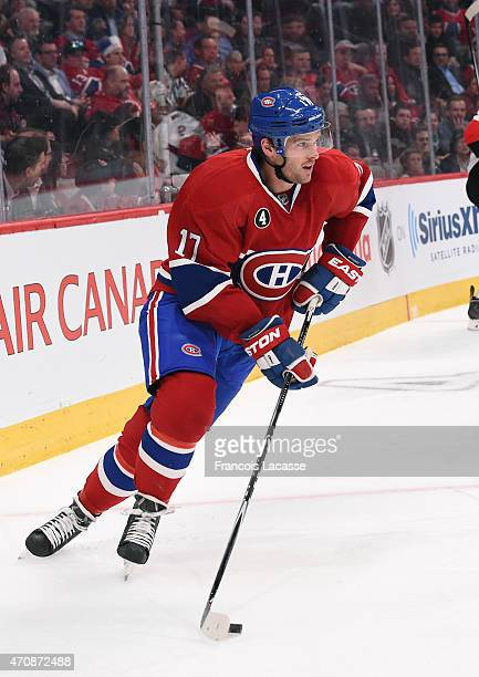 Torrey Mitchell of the Montreal Canadiens looks to pass the puck against the Ottawa Senators in Game One of the Eastern Conference Quarterfinals...