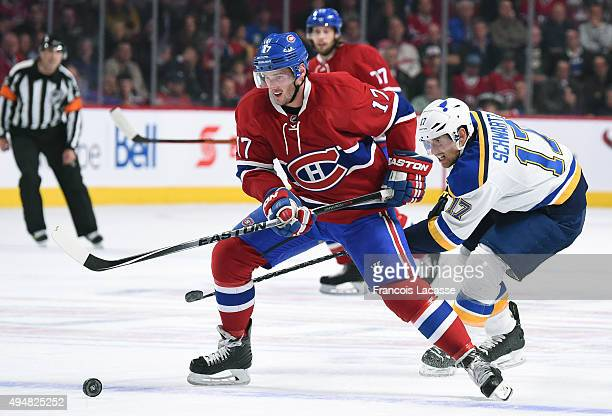 Torrey Mitchell of the Montreal Canadiens looks to pass the puck against the StLouis Blues in the NHL game at the Bell Centre on October 20 2015 in...