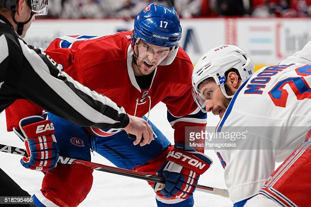 Torrey Mitchell of the Montreal Canadiens takes a faceoff during the NHL game against the New York Rangers at the Bell Centre on March 26 2016 in...
