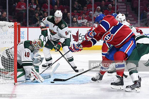 Torrey Mitchell of the Montreal Canadiens takes a shot on goal Devan Dubnyk of the Minnesota Wild in the NHL game at the Bell Centre on March 12 2016...