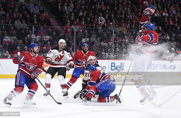 Torrey Mitchell the Montreal Canadiens tries to catch the puck against the New Jersey Devils in the NHL game at the Bell Centre on January 6 2015 in...