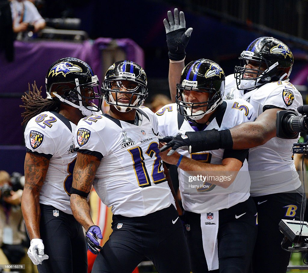 Torrey Smith Jacoby Jones and Joe Flacco of the Baltimore Ravens celebrate after Jones scored on a 56yard touchdown pass by Flacco in the second...