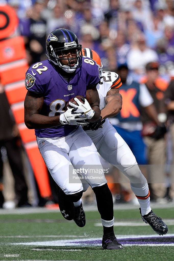 Torrey Smith #82 of the Baltimore Ravens avoids the tackle of Joe Haden #23 of the Cleveland Browns after catching a pass during the second half of a game at M&T Bank Stadium on September 15, 2013 in Baltimore, Maryland.