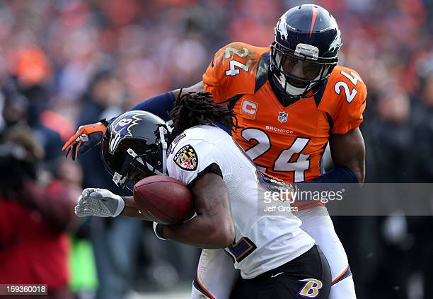 Torrey Smith of the Baltimore Ravens can't make the catch on a pass as he is defended by Champ Bailey of the Denver Broncos in the second quarter...