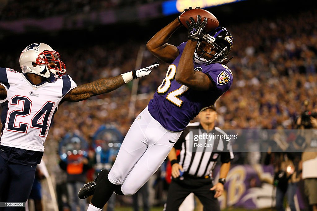 Torrey Smith #82 of the Baltimore Ravens catches a 25-yard touchdown recpetion in the second quarter against Kyle Arrington #24 of the New England Patriots at M&T Bank Stadium on September 23, 2012 in Baltimore, Maryland.