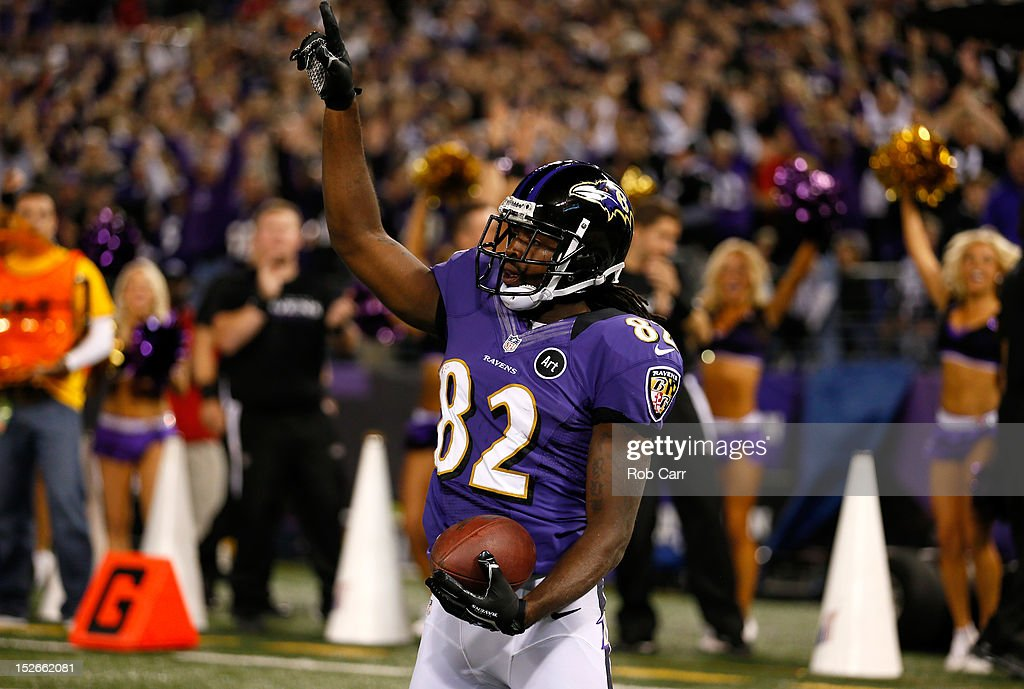 Torrey Smith #82 of the Baltimore Ravens celebrates after he scored a 25-yard touchdown recpetion in the second quarter against the New England Patriots at M&T Bank Stadium on September 23, 2012 in Baltimore, Maryland.