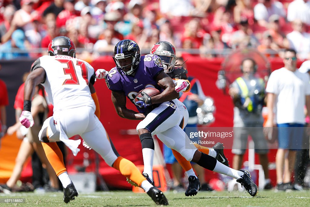 Torrey Smith of the Baltimore Ravens makes a 15yard touchdown reception in the first quarter of the game against the Tampa Bay Buccaneers at Raymond...