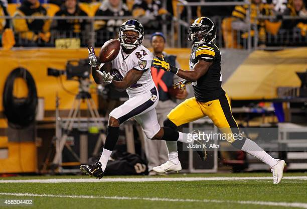 Torrey Smith of the Baltimore Ravens makes a touchdown catch in front of Brice McCain of the Pittsburgh Steelers at Heinz Field on November 2 2014 in...