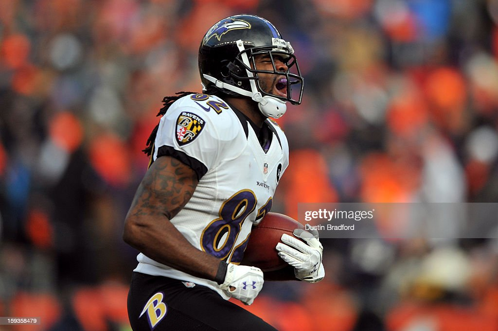 Torrey Smith of the Baltimore Ravens reacts after he scored a 59yard touchdown reception in the first quarter against the Denver Broncos during the...