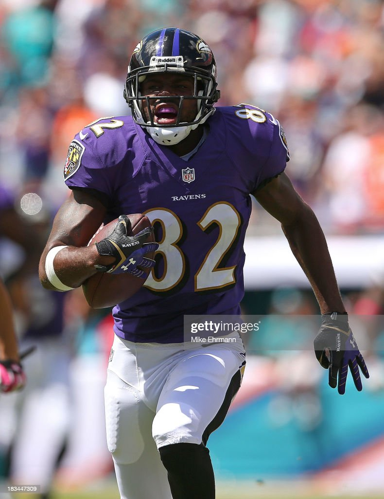 Torrey Smith #82 of the Baltimore Ravens runs after a catch during a game against the Miami Dolphins at Sun Life Stadium on October 6, 2013 in Miami Gardens, Florida.