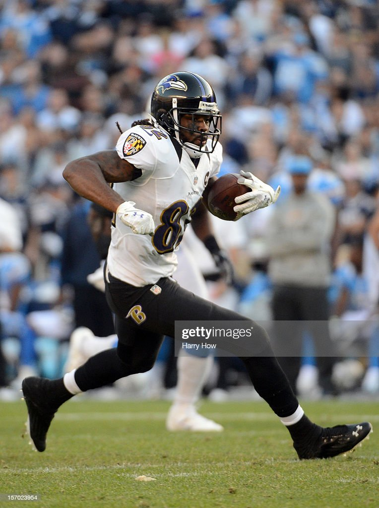 <a gi-track='captionPersonalityLinkClicked' href=/galleries/search?phrase=Torrey+Smith&family=editorial&specificpeople=5527843 ng-click='$event.stopPropagation()'>Torrey Smith</a> #82 of the Baltimore Ravens runs after his catch during a 16-13 win over the San Diego Chargers in overtime at Qualcomm Stadium on November 25, 2012 in San Diego, California.