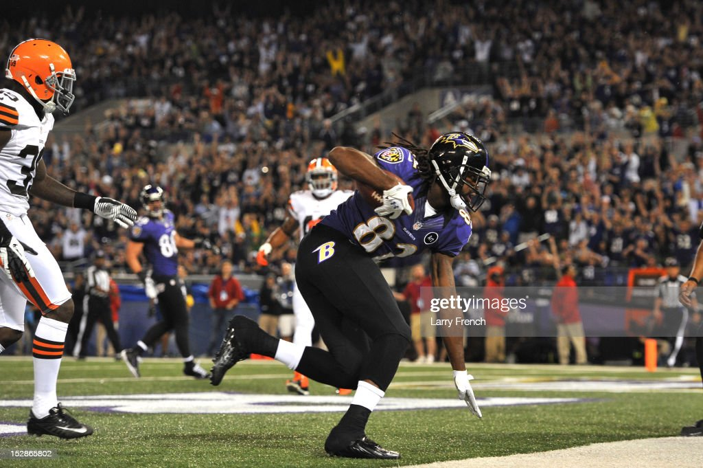 Torrey Smith of the Baltimore Ravens scores a touchdown against the Cleveland Browns at MT Bank Stadium on September 27 2012 in Baltimore Maryland...