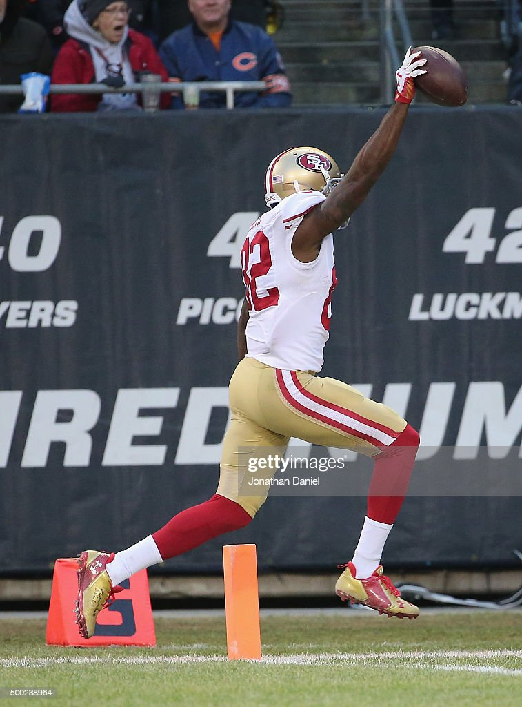 Torrey Smith of the San Francisco 49ers crosses the goalline to score the winning touchdown against the Chicago Bears at Soldier Field on December 6...
