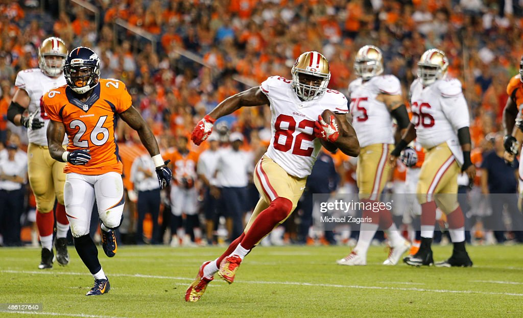 Torrey Smith of the San Francisco 49ers runs after making a reception during the game against the Denver Broncos at Sports Authority Field on August...