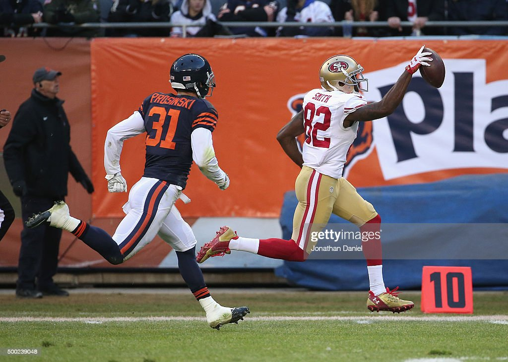 Torrey Smith of the San Francisco 49ers runs for the winning touchdown after a catch chased by Chris Prosinski of the Chicago Bears at Soldier Field...
