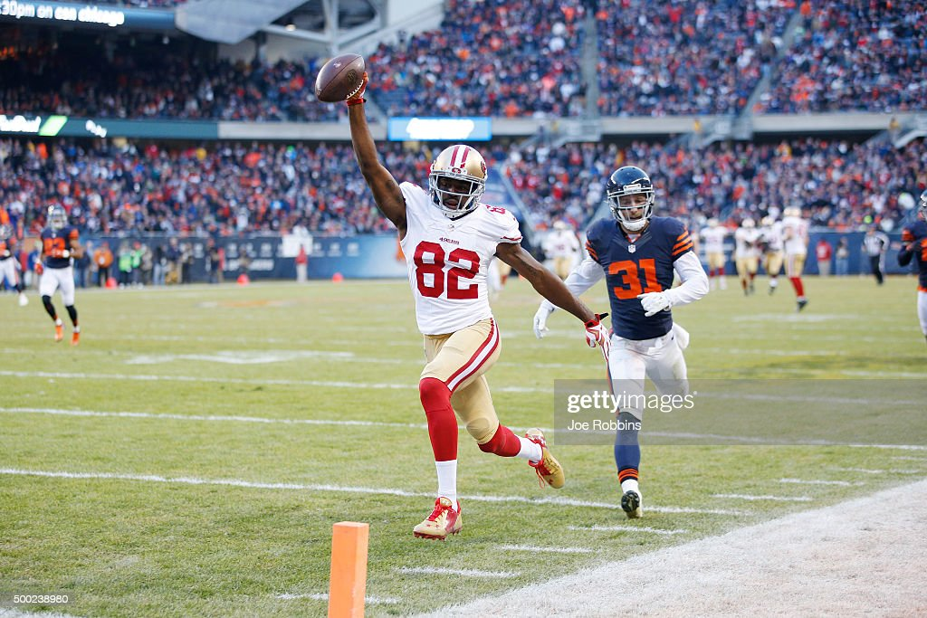 Torrey Smith of the San Francisco 49ers runs into the end zone with a 71yard touchdown reception against the Chicago Bears to win the game in...