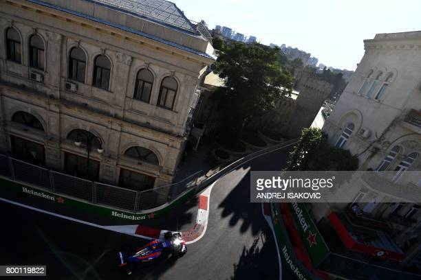 TOPSHOT Torro Rosso's Russian driver Daniil Kvyat steers his car during the second practice session of the Formula One Azerbaijan Grand Prix at the...