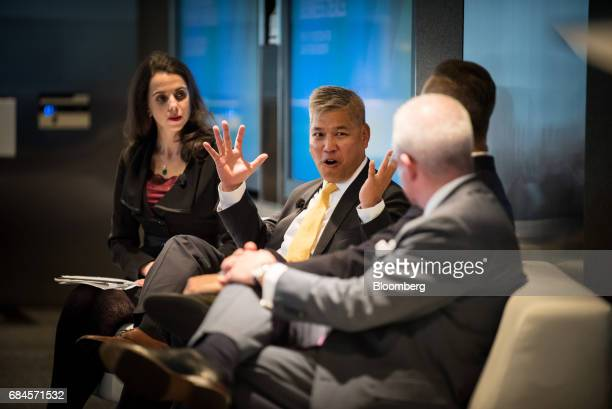 Torsdon Poon transaction tax leader of Ernst Young LLP center speaks during 'The Future of International Business Deals How to Position for LongTerm...