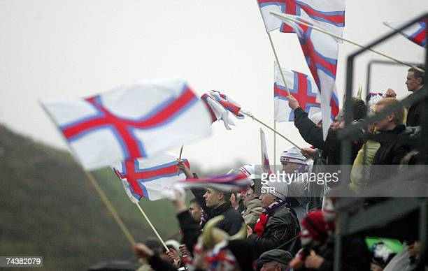 Faroe Islands' supporters celebrate at the end of the Euro 2008 group B qualifiying football match against Italy at Torsvollur stadium in Torshavn 02...