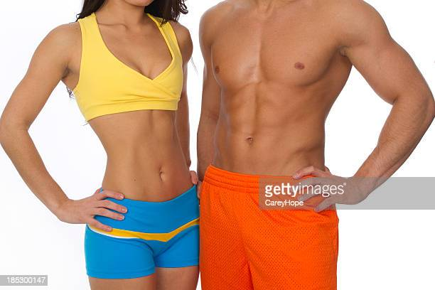 torso of fit man and woman
